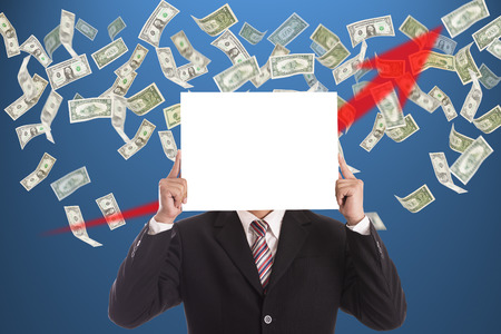 Businessman hold white blank for add massage with glowing money concept photo