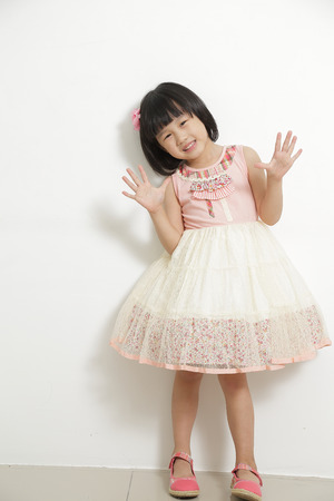 8 year old girl: Little girl posing and enjoy in studio