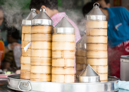 Dim sum bamboo steaming for serve to customer photo