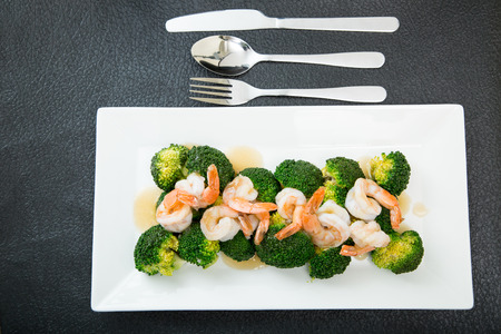 brocoli: Gravy and Shrimp with broccoli on white dish