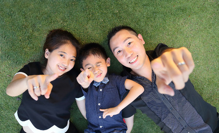 Asian Family portrait in public garden Stock Photo