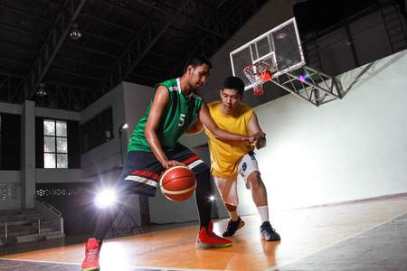 Basketball carry ball for shoot score in the game match
