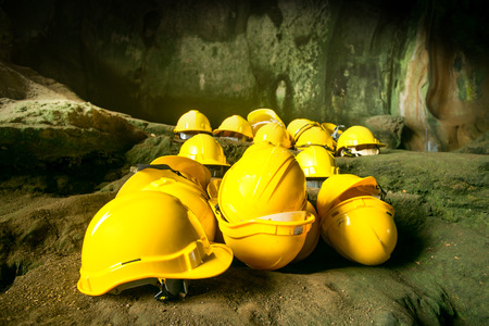 safety wear: Safety helmets in construction site in Underground mine passage way Stock Photo