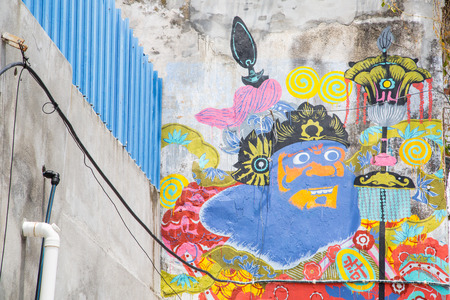 georgetown: GEORGE TOWN,PENANG ,MALAYSIA- CIRCA March 26, 2015: Public street art Giant God painted on the wall with Multiple color in Georgetown, Penang, Malaysia.