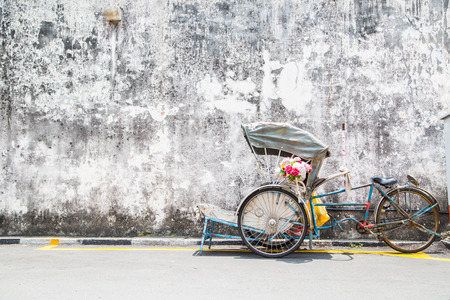 circa: GEORGE TOWN,PENANG ,MALAYSIA- CIRCA March 26, 2015: Trishaw vintage style wait for service traveller  in Georgetown, Penang, Malaysia. Editorial