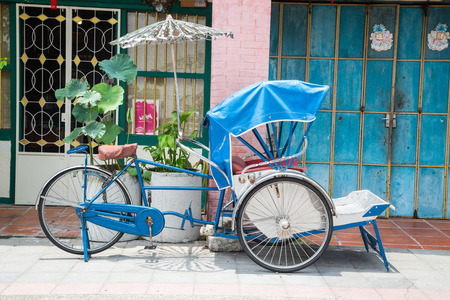 trishaw: GEORGE TOWN,PENANG ,MALAYSIA- CIRCA March 26, 2015: Trishaw vintage style wait for service traveller  in Georgetown, Penang, Malaysia. Editorial