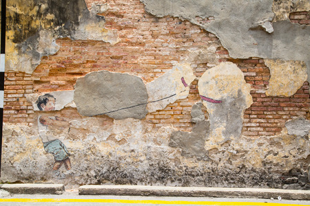 ernest: GEORGE TOWN,PENANG ,MALAYSIA- CIRCA March 26, 2015: Public street art Little boy with pet dinosaur  on the wall by Lithuanian artist Ernest Zacharevic in Georgetown, Penang, Malaysia. Editorial