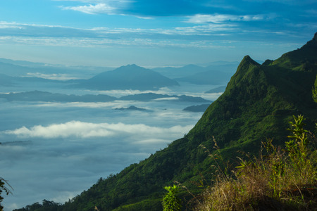 smokies: Mountain Pha Tang sunrise and mist in the morning Thailand. Stock Photo