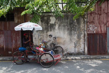 georgetown: GEORGE TOWN,PENANG ,MALAYSIA- CIRCA March 26, 2015: Public street art Name Children on a bicycle painted 3D on the wall thats two little  Chinese girls riding bicycle.  in Georgetown, Penang, Malaysia.