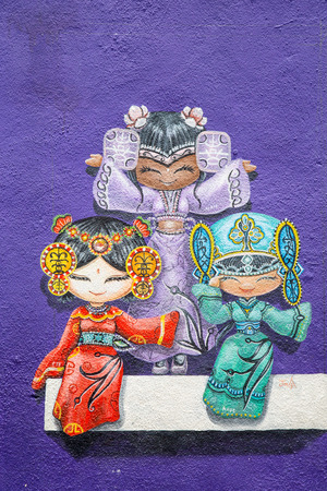 georgetown: GEORGE TOWN,PENANG ,MALAYSIA- CIRCA March 26, 2015: Public street art Name Three chinese dolls on the wall  with black and white color in Georgetown, Penang, Malaysia. Editorial