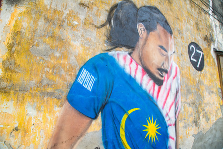 local 27: GEORGE TOWN,PENANG ,MALAYSIA- CIRCA March 26, 2015: Public street art Name 27 Football player on the wall by Local Artist in Georgetown, Penang, Malaysia