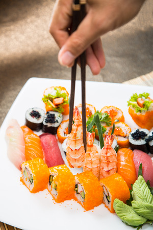 chop stick: Sushi set of Japnese food with chop stick Stock Photo