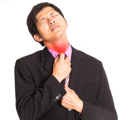 uncomfortable: Uncomfortable ,businessman use hand for pull at his collar Stock Photo