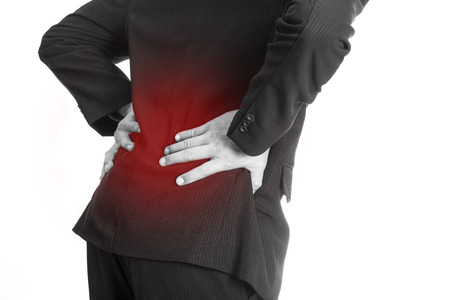 backpain: Backache ,Businessman holding hand at Back of body cause of pain back area after finished work in Office.