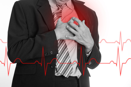 Heart Attack ,Use hand grabbing a chest with white background Standard-Bild