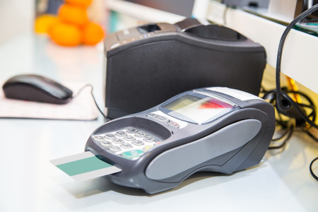 payment machine and Credit card in supermarket photo