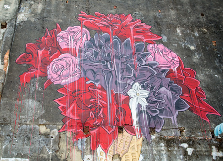 georgetown: GEORGE TOWN,PENANG ,MALAYSIA- CIRCA March 26, 2015: Public street art Name Colorful Flower painted on the wall  with black and white color in Georgetown, Penang, Malaysia.