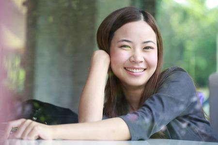 beautiful teen girl: Young Asian women looking  beside mirror in cafe shop
