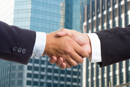 negotiation business: Businessman shake hands for deal thier business. Stock Photo