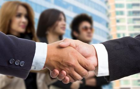 Businessman shake hands for deal thier business. Stok Fotoğraf