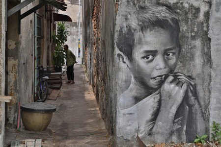 armenian woman: GEORGE TOWN,PENANG ,MALAYSIA- CIRCA March 26, 2015: Public street Black and White boy painting Street Art by Julia Volchkova with realistic mood ,Graffiti in George Town, Malaysia