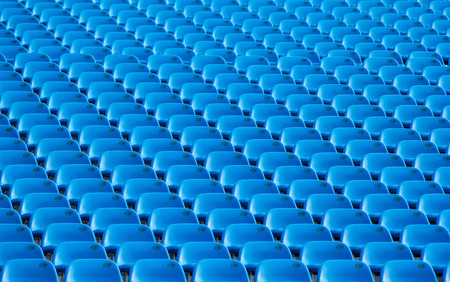 thier: Seat in Stadium for fan sport come to enjoy thier game.