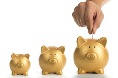 growing business: Piggy bank increasing your finance growing with white background. Stock Photo