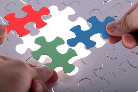 hands together: Jigsaw puzzle piece ,complete your mission