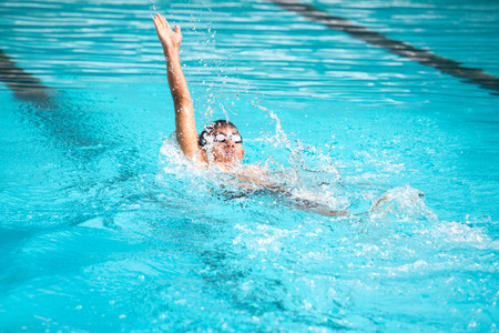 backstroke: Backstroke swimmer  competition on the swimming pool