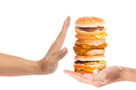 junk: Hand refusing junk food with white background Stock Photo