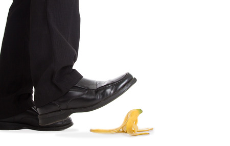 tripping: Businessman walking foot press banana peel and slip fall to floor.