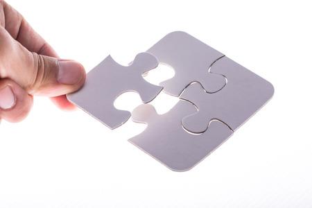 Puzzlestück, vervollständigen Sie Ihre Mission Standard-Bild - 40563304