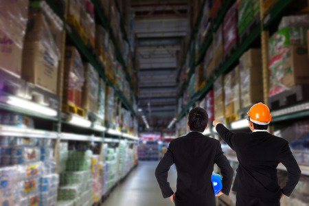 Two Engineers Check stock product in warehouse Banco de Imagens