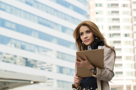 important phone call: Businesswoman note and think her job with wood board. Stock Photo