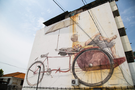 paddler: GEORGE TOWN,PENANG ,MALAYSIA- CIRCA March 26, 2015: Public street ,The Awaiting Trishaw Paddler painting Art by Local and Famaus with realistic mood ,Graffiti in George Town, Malaysia Editorial