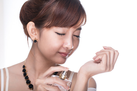 ladylike: Apply Perfume woman with white background