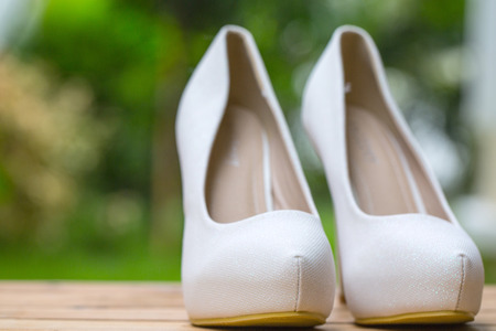opentoe: Woman shoes fashion on wood table in the garden.