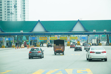 KUALA LUMPUR ,MALAYSIA -June 24 ,2015 ,Toll way payment station car with smart tag and touch&go in Malaysia ,Penang.