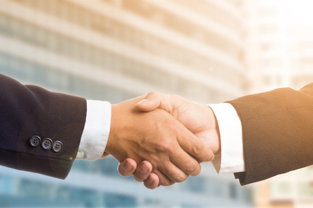 thier: Businessman shake hands for deal thier business. Stock Photo