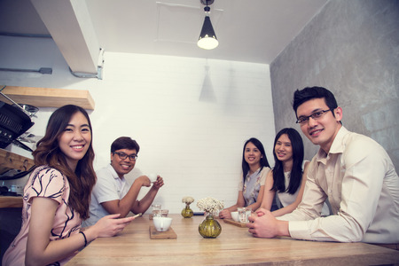 Group of young adult talking and meeting together in coffee shop. 스톡 콘텐츠