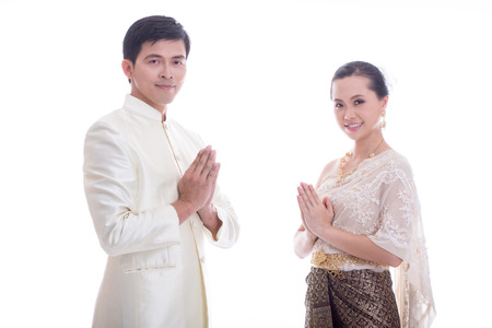 thai culture: Thai Man and women welcome with traditional Thai suit in Studio