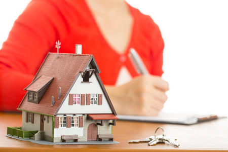 Woman calculate and plan for your good property with real agency property.