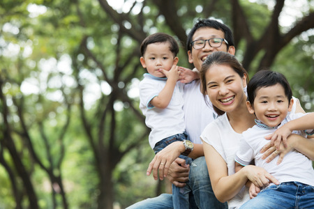 Happy Family enjoy and do activity together in Garden. Stock Photo
