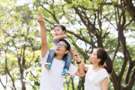 asian success: Happy Family enjoy and do activity together in Garden. Stock Photo
