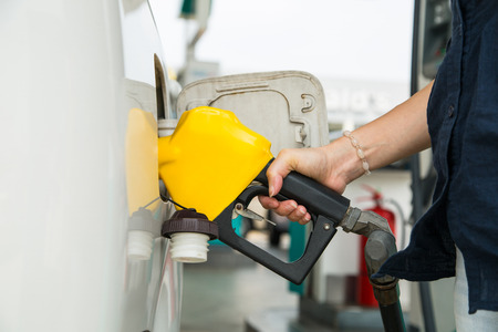 unleaded: Fuel station service fill energy into your car at gas station Stock Photo