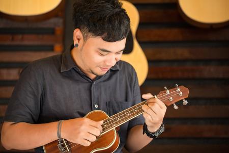 e guitar: Ukulele Guitar teacher teach music in school