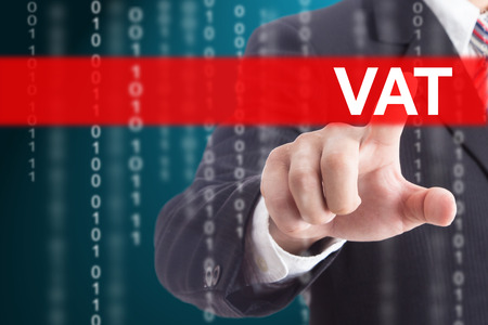 Businessman touching VAT sign for control and management your company. Stock Photo