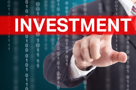 Businessman touching investment sign for control and management your company.