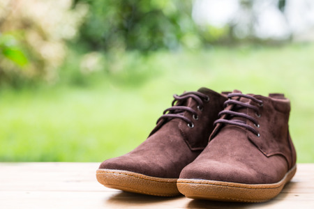 opentoe: Man shoes fashion on wood table in the garden.