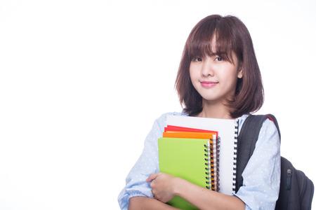 uniforme escolar: estudio de la muchacha del estudiante con el fondo blanco. Foto de archivo